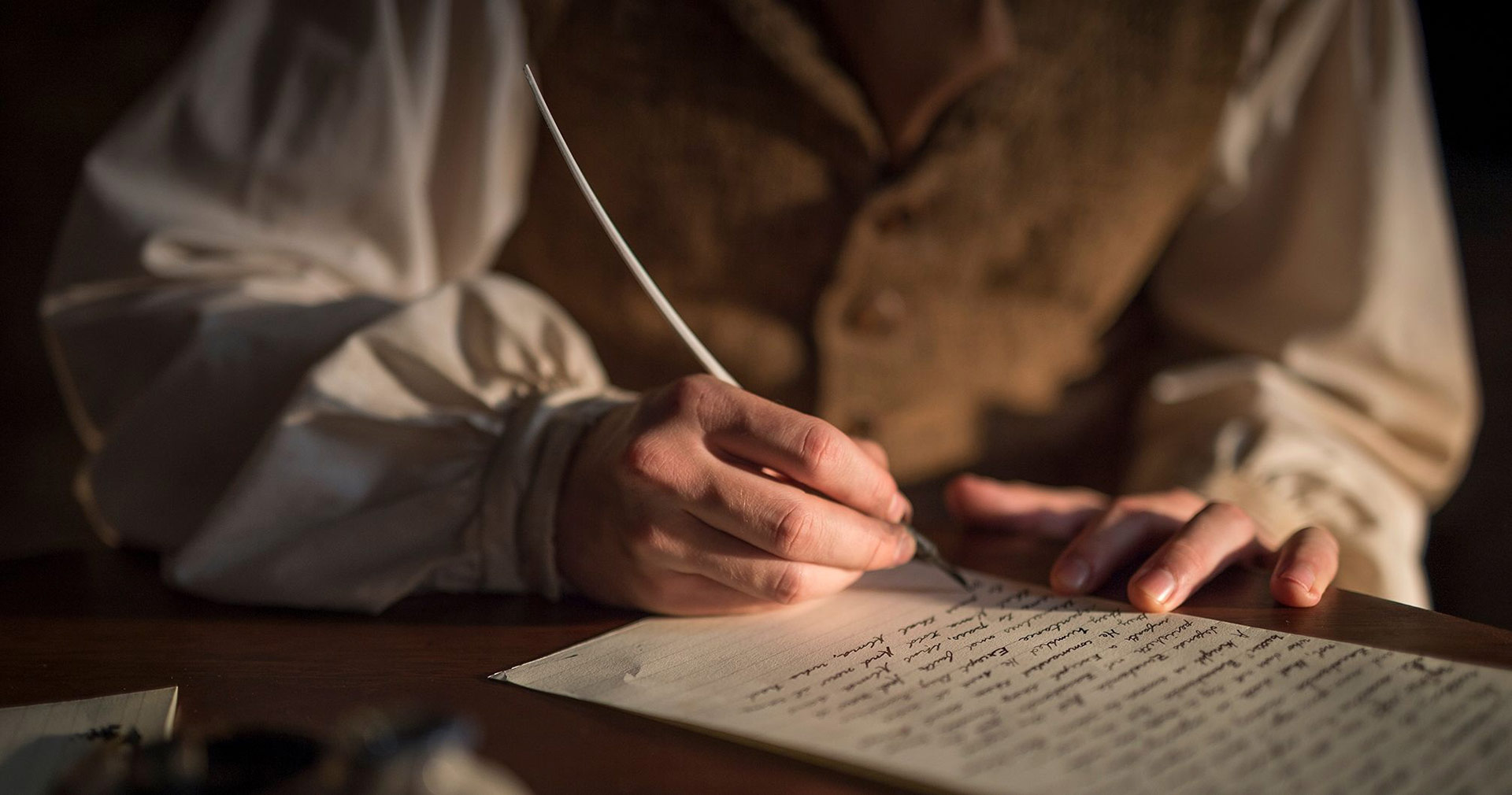 Oliver Cowdery scribing the text of the Book of Mormon. Image via Church of Jesus Christ.