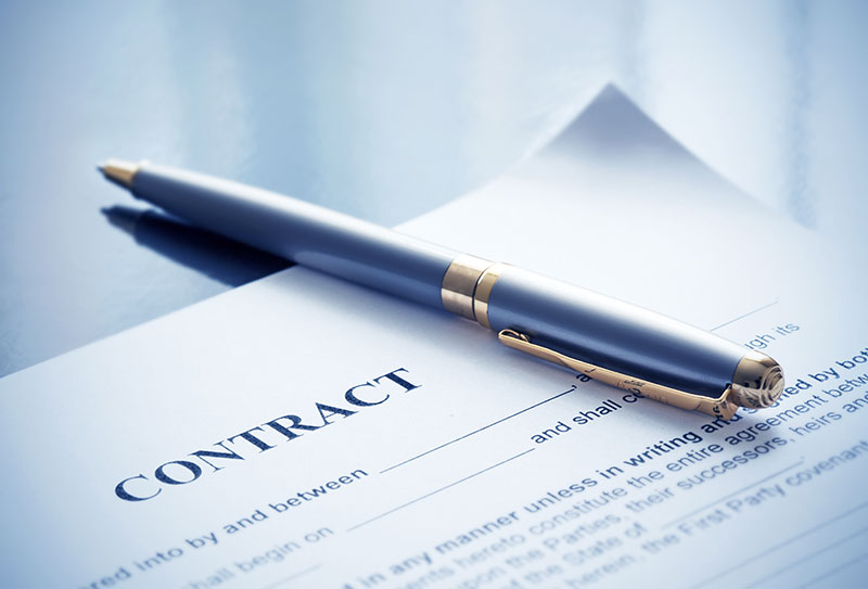 Image of contract via Adobe Stock. Photography by Maksym Dykha.