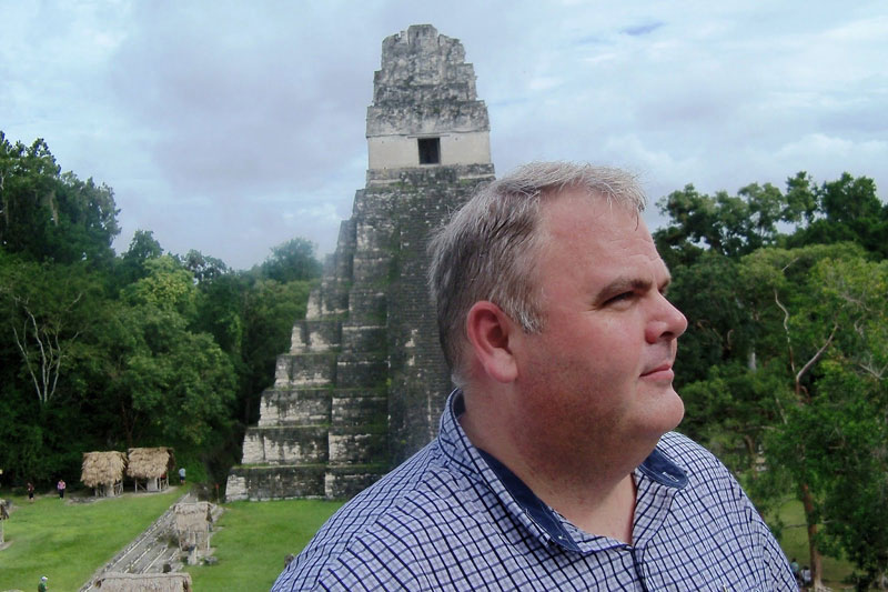 Mark Wright with Tikal Temple I in Background. Photo by Kirk Magleby.
