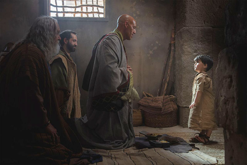 Wise men kneel before the Christ child. Image via comeuntochrist.org.