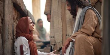 Jesus heals a woman with an issue of blood. Image via lds.org