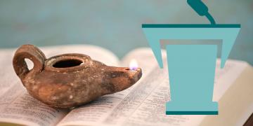 Ancient oil lamp on open bible. Image by R. Gino Santa Maria via Adobe Stock
