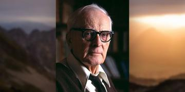 Portrait of Hugh Nibley with mountains.